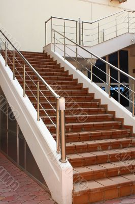 Stone ladder with a metal handrail