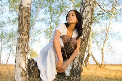 beauty girl sit on the birch tree 2