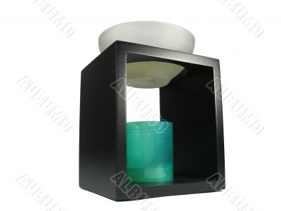 Chinese aroma lamp with candle over white background
