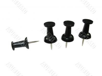 Macro image of black push pins isolated on white background
