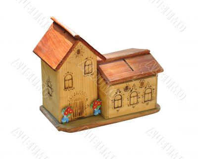 small wooden toy house isolated over white background
