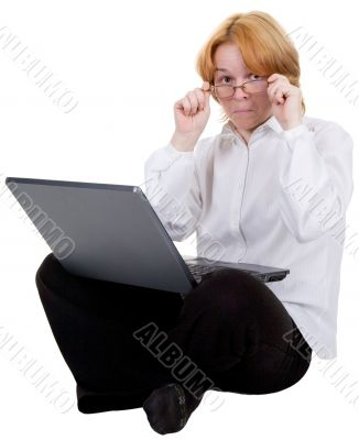 Woman sitting with the laptop