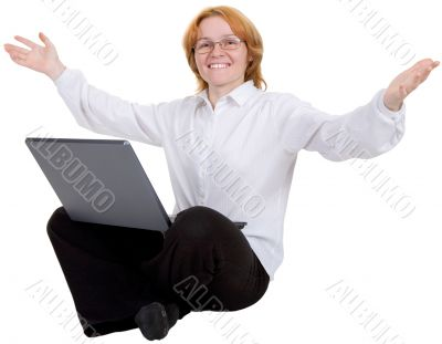 Woman sitting with the laptop on white