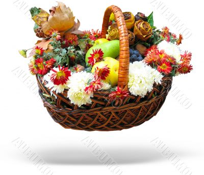 Wicker basket Autumn harvesting vegetables, fruits, leaves and flowers isolated over white background with shadow