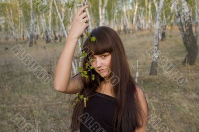 beauty girl stands with birch twigs 2