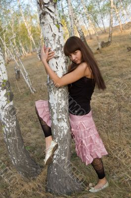 girl hugging birch