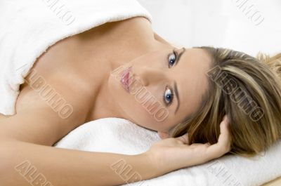 charming young female in towel looking you