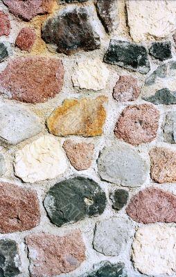 Multicolored stone wall vertical