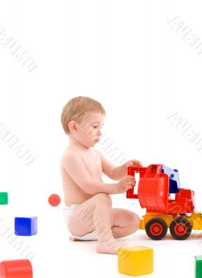 Little boy play with toys