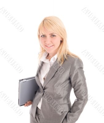 Smiling  businesswoman holding laptop under one`s arm