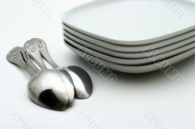 Plates and shining spoons