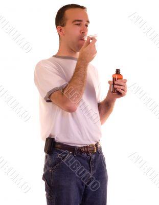 Man Swallowing Medicine