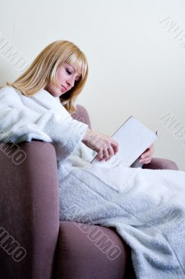 Paris Hiltion look-a-like reading a book in her bathrobe