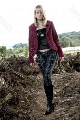 Paris Hilton look-a-like fashion shoot wal;king towards you