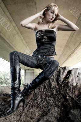 Paris Hilton look-a-like fashion shoot on a tree stump