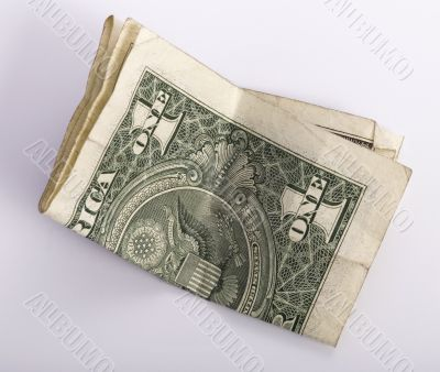 one crumpled one dollar banknote