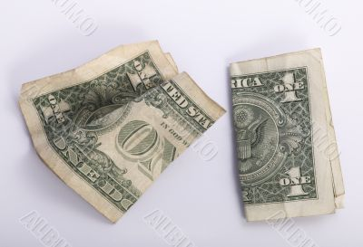 two crumpled one dollar banknotes