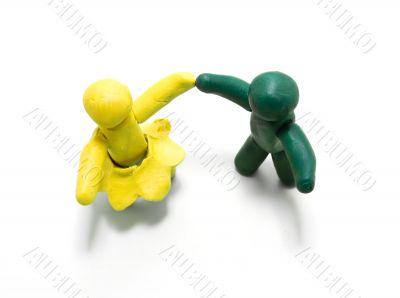 Two clay figures dancing