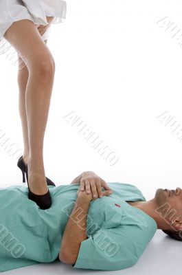 patient keeping leg on doctor`s chest
