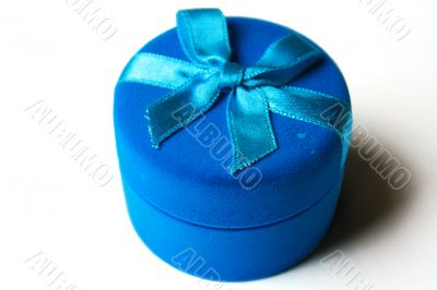 Dark blue box from a velvet with a blue tape