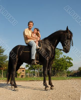 father, daughter, and horse