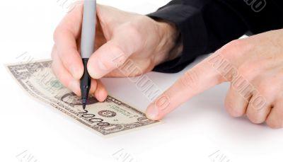 Male hand draw nil on dollar