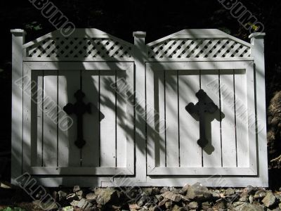 black cross on white wooden doors