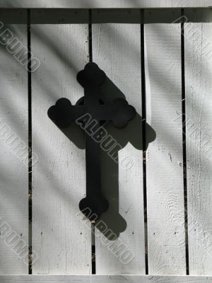 black cross on a white door