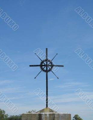metal cross and blue sky