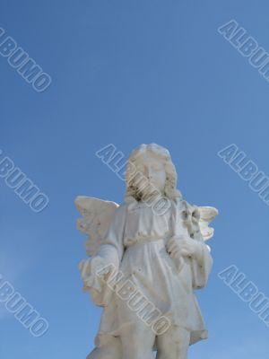 stone angel and blue sky