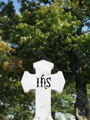 stone cross with tree