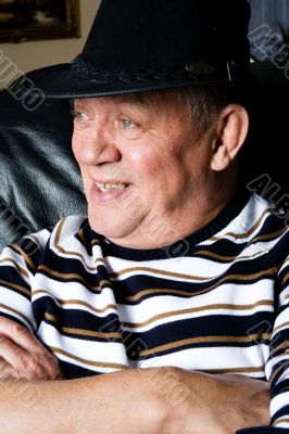 Grandfather with a black cowboy hat posing
