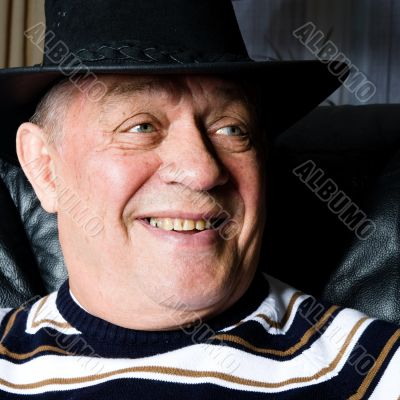 Grandfather who is proud on his new cowboy hat