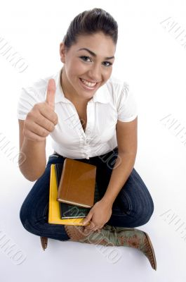 pretty teenager girl posing with thumbs up