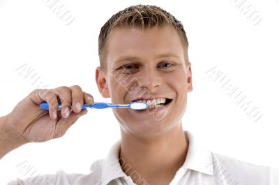 healthy male brushing his teeth