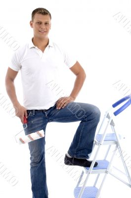 handsome painter standing on ladder chair