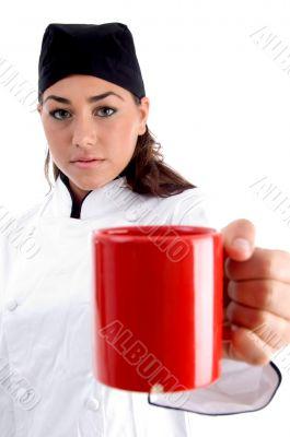 chef showing you coffee mug
