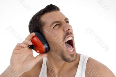 young guy enjoying rock music with full volume