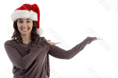 young female in christmas hat with open palms