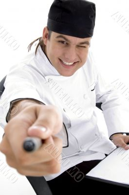 happy male chef posing in front of camera