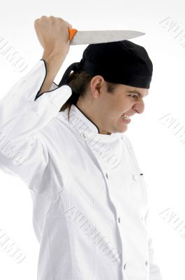 angered chef posing with knife