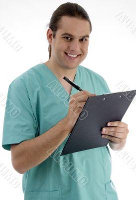 handsome surgeon writing prescription