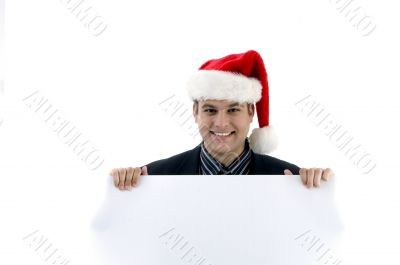 accountant in christmas hat holding placard