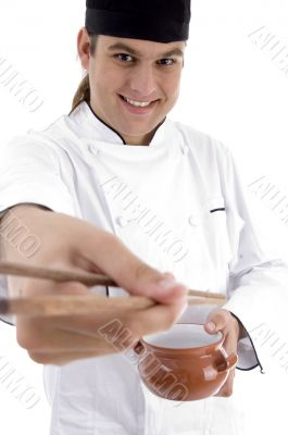 chef presenting chinese dish with chopstick