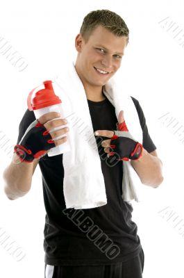 smiling man indicating bottle