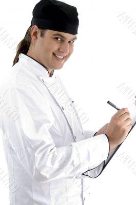 caucasian chef maintaining menu