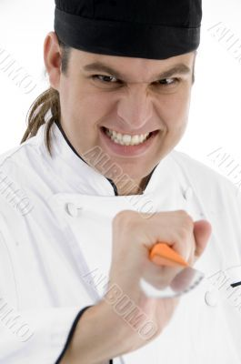 male chef showing kitchen tool facial expressions