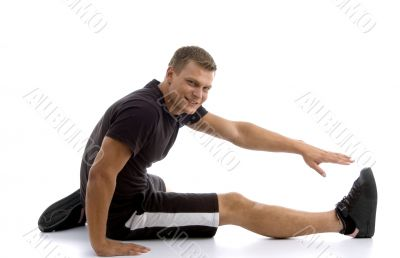 male stretching his leg