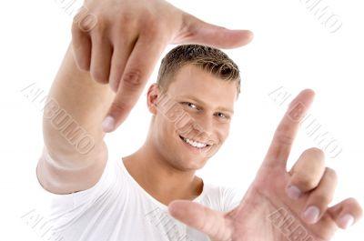 handsome model framing his face