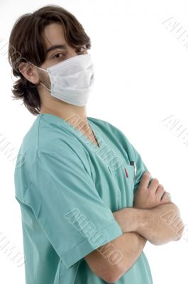 doctor in scrubs and facemask